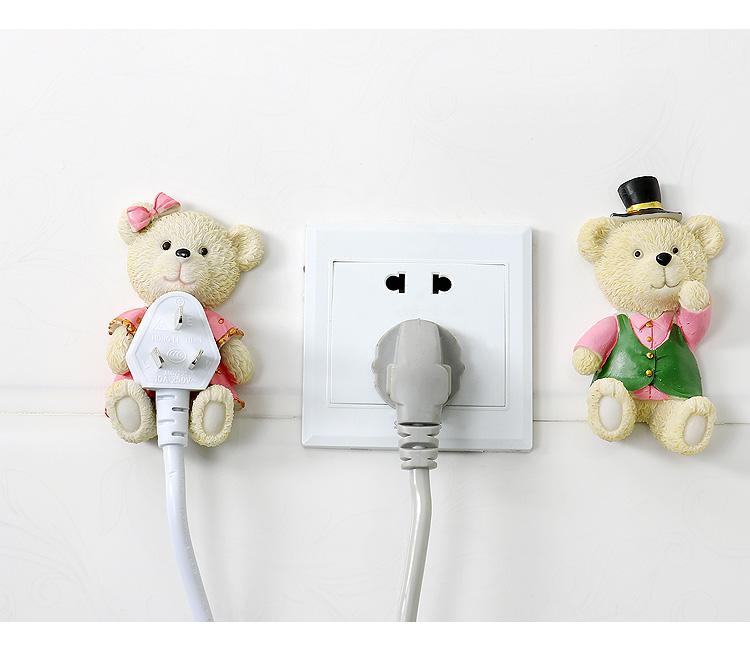 ตุ๊กตาวางปลั๊กไฟติดกำแพง