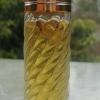 น้ำมันเสน่ห์ สาริกาไม้คูณ ครูบาเดชปลุกเสก