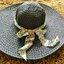 หมวกปีกกว้าง หมวกเที่ยวทะเล หมวกปีกว้างสีดำ แต่งโบว์ใหญ่ลายเสือเก๋ๆ thumbnail 1