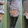 กระเป๋าสะพายเสือและสิงโต