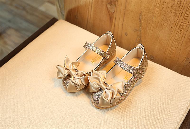 รองเท้าคัชชู ผูกโบว์ กากเพชร สีทอง