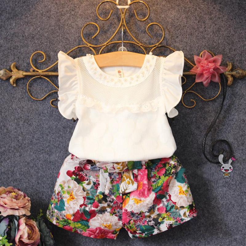 ชุดเด็ก : ชุดเสืื้อสีขาวแขนระบาย+กางเกงลายดอก