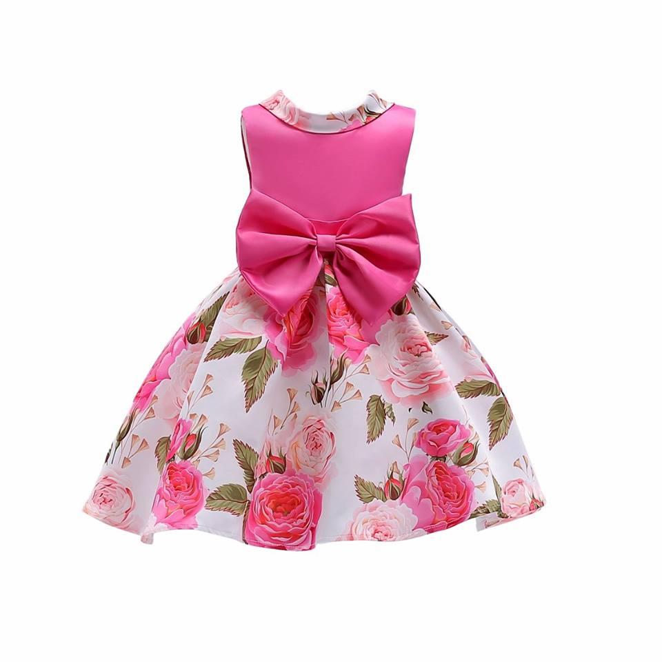 ชุดเด็ก : เดรสสีชมพู บานเย็น ลายดอกไม้
