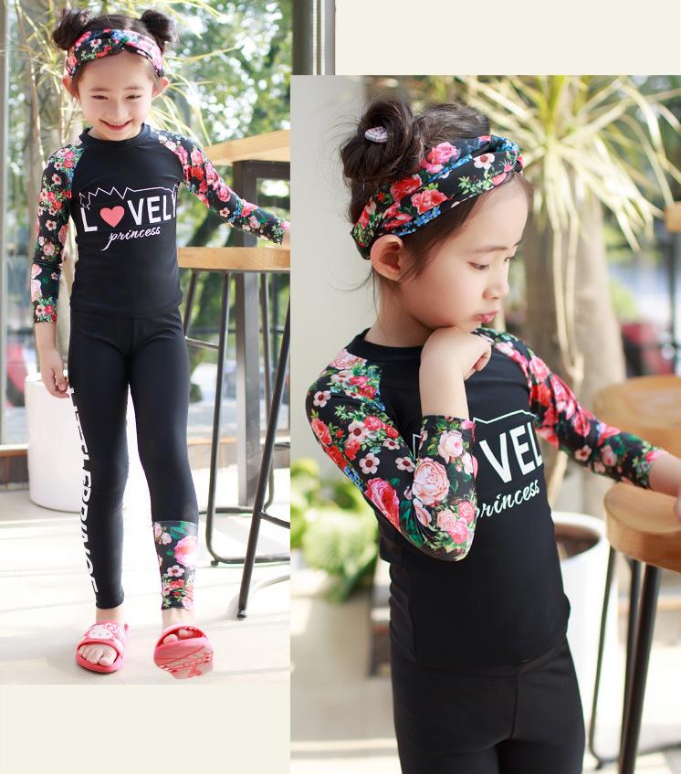 ชุดว่ายน้ำเด็ก : ชุดเซ็ตเสื้อแขนยาวลายดอก ดำ+กางเกงขายาว เด็ก