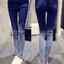 กางเกงยีนส์แฟชั่น แบบขาดๆปลายขาไล่เฉดตามแบบ-1563-สีน้ำเงิน thumbnail 1